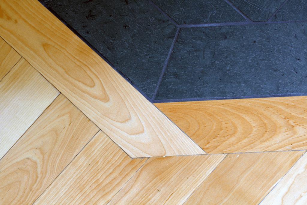 Image of slate and wood floor detail by Free Range Builders
